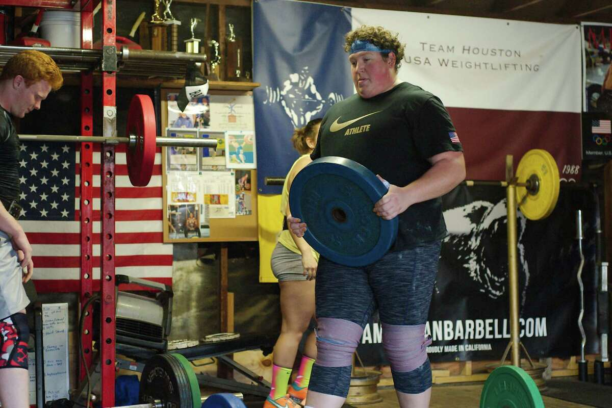 World champion weight lifter Sarah Robles adds weight as she works through her routine Tuesday, Feb. 6.