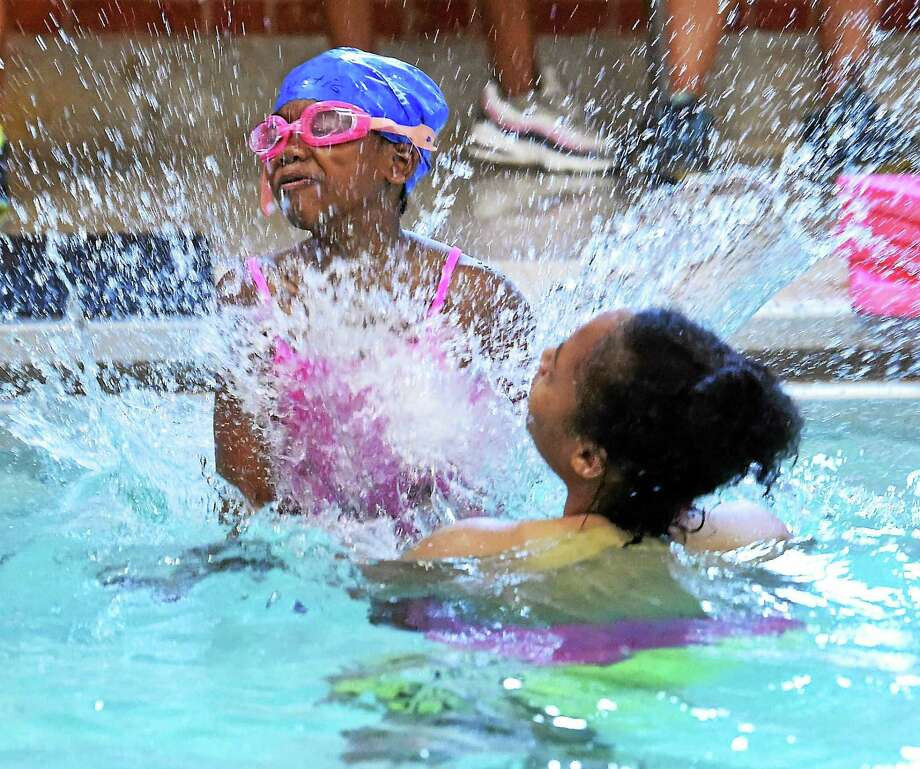 (Mara Lavitt ó New Haven Register) ¬ July 8, 2014 NewHaven ¬ The pool at LEAP has reopened to teach LEAP children to swim. This class was for 7-8 year old girls. Dana Morrison age 8, practicedjumping into the pool and into the arms of instructor Kyla Sead. ¬ mlavitt@newhavenregister.com ¬  ¬  ¬ Photo: Mara Lavitt / Journal Register Co. / Mara Lavitt