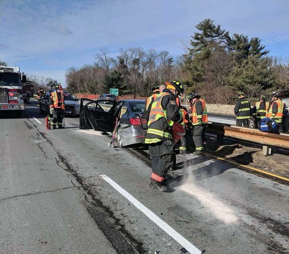 The Westport Fire Department, alongside Connecticut State Police, responded for a two-vehicle crash on the Merritt Parkway on Feb. 8, 2018. Photo: Contributed Photo / Westport Fire Department / Contributed Photo / Connecticut Post Contributed