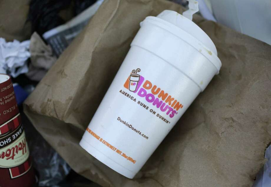 A Dunkin' Donuts' foam cup is discarded in a trash bin in New York. The polystyrene foam cups will be completely phased out by 2020. Photo: Mark Lennihan / Associated Press / Copyright 2018 The Associated Press. All rights reserved.