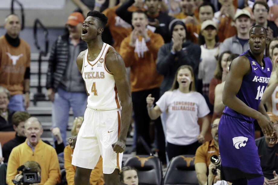 Texas forward Mohamed Bamba (4) reacts after he scored against Kansas State forward Makol Mawien (14) and was fouled on the play during the first half of an NCAA college basketball game Wednesday, Feb. 7, 2018, in Austin, Texas. (AP Photo/Eric Gay) Photo: Eric Gay, STF / Associated Press / Copyright 2018 The Associated Press. All rights reserved.