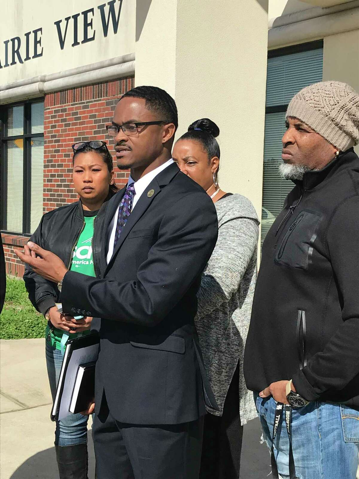 JonathanMiller, flanked by a handful of supporters, speaks out Thursday in front of Prairie View City.Millerprotested the dismissal of the misdemeanor case against the white police officer who arrested and Tased him in 2015.