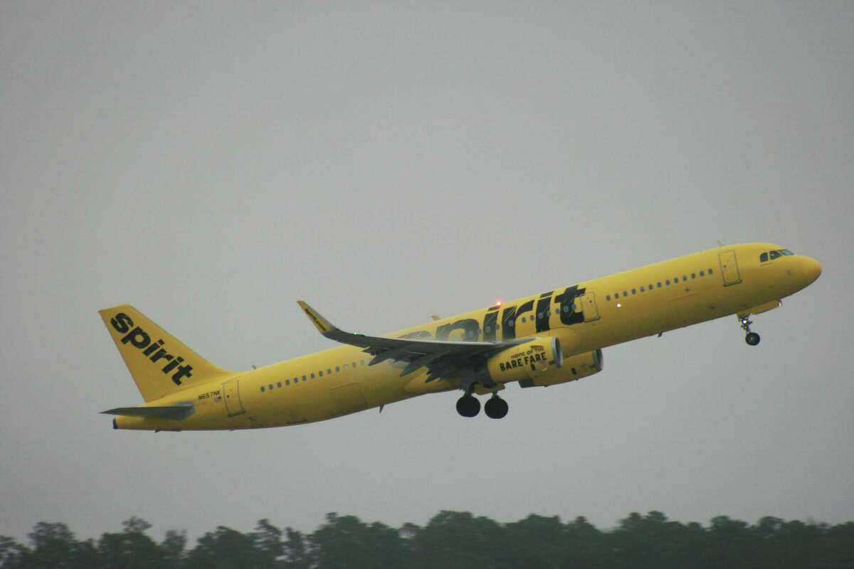 A Spirit Airlines Airbus A321 leaves the runway at Bush Intercontinental Airport.