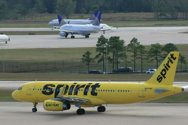 A Spirit Airlines Airbus taxis at Bush Intercontinental Airport.