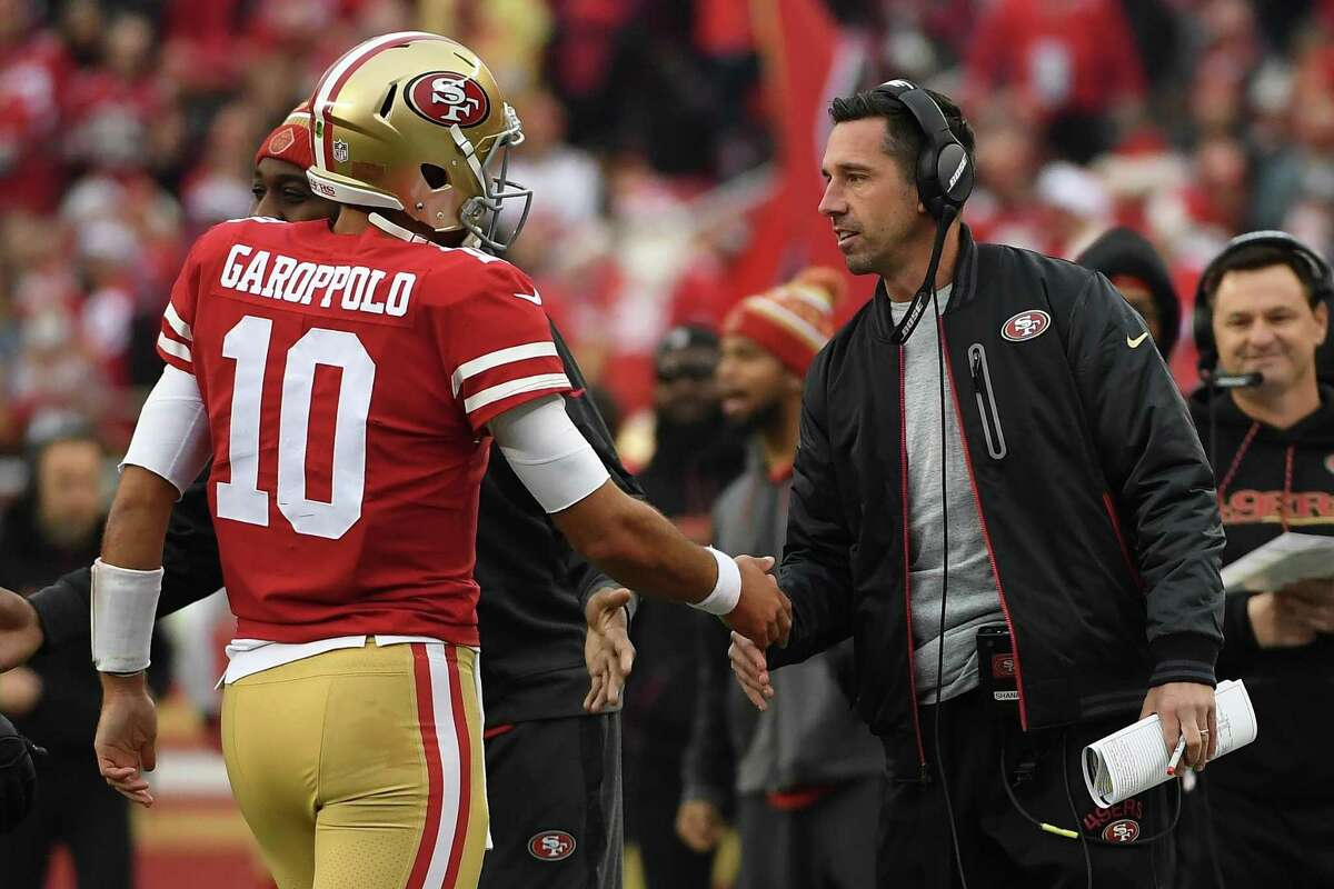 Head coach Kyle Shanahan of the San Francisco 49ers congratulates Jimmy Garoppolo #10 after a one-yard touchdown run against the Jacksonville Jaguars during their NFL game at Levi's Stadium on December 24, 2017 in Santa Clara, California.
