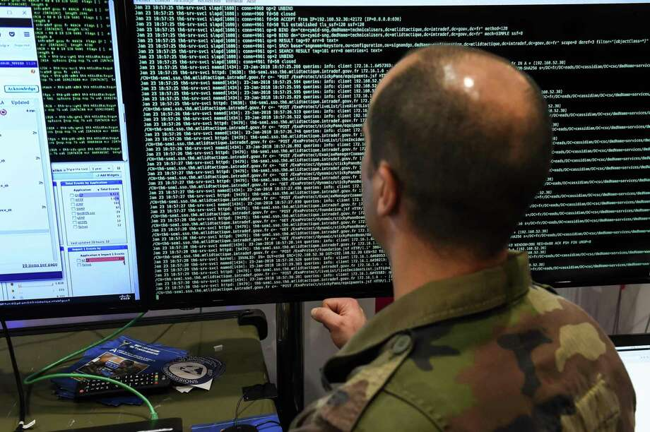 File photo of a member of the military specialised in cyber defense during the 10th International Cybersecurity Forum. Noblis, headquartered in Virginia, is expanding its San Antonio office from 21 to more than 100 employees over the next three years. Photo: PHILIPPE HUGUEN /AFP /Getty Images / AFP or licensors
