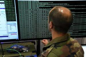 File photo of a member of the military specialised in cyber defense during the 10th International Cybersecurity Forum. Noblis, headquartered in Virginia, is expanding its San Antonio office from 21 to more than 100 employees over the next three years.