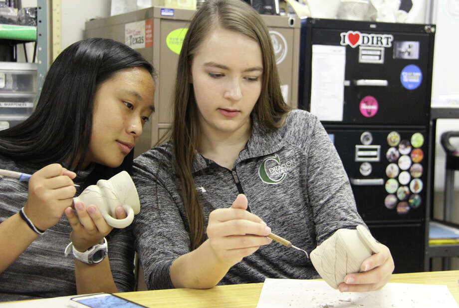 Seniors Ashley Wu and Maddie Smith, who is co-chairing the annual fundraiser, create bowls for the 13th Annual Empty Bowls that will be held at The John Cooper School on February 24. Photo: Photo Courtesy Of The John Cooper School