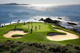 Players on the 7th green on the Pebble Beach Golf Links during round 1 of the AT&T Pebble Beach Pro-Am in Pebble Beach, Calif., seen on Thursday Feb. 8, 2018.