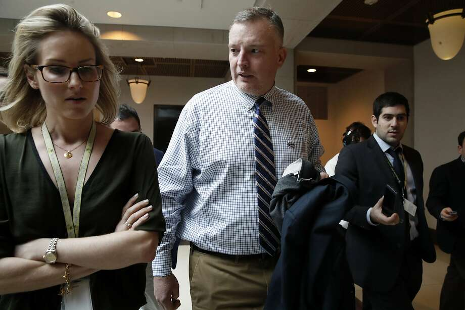 FILE - In this Jan. 16, 2018, file photo, Rep. Thomas Rooney, R-Fla., center, talks with reporters as he leaves a House Intelligence Committee meeting where the committee is interviewing former White House strategist Steve Bannon behind closed doors on Capitol Hill in Washington. Photo: Jacquelyn Martin, Associated Press