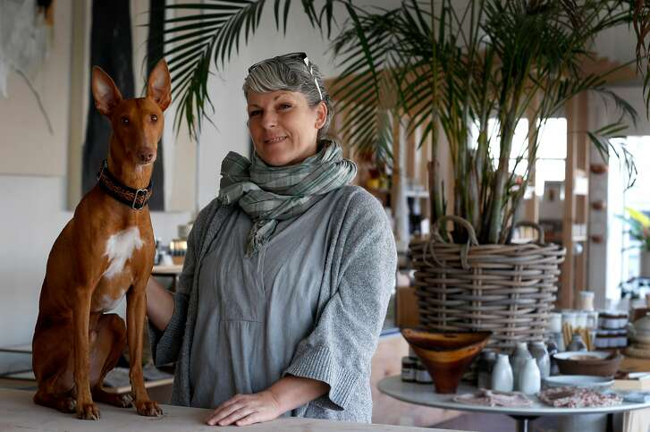 Yonder Shop owner Linda Fahey and her dog Obi are seen inside her store and studio at 11th Avenue and Cabrillo Street in San Francisco, Calif. on Friday, Feb. 2, 2018.
