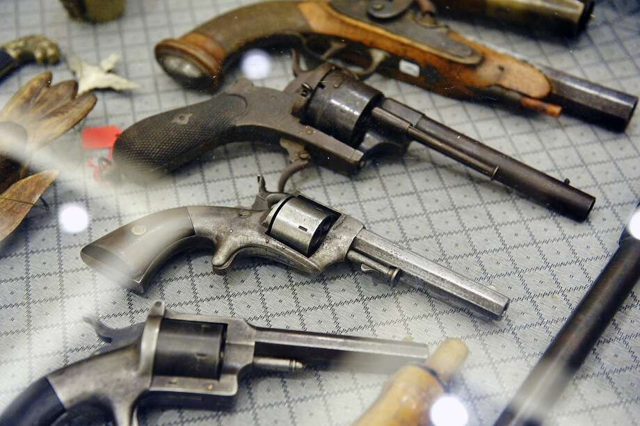 Civil War-era pistols at a 2014 gun show in Saratoga Springs, N.Y. A California appeals court poked a hole in the state's one-gun-per-month limit for firearms purchases Thursday, ruling that it doesn't apply to several thousand federally licensed gun collectors. Photo: Albany Times Union