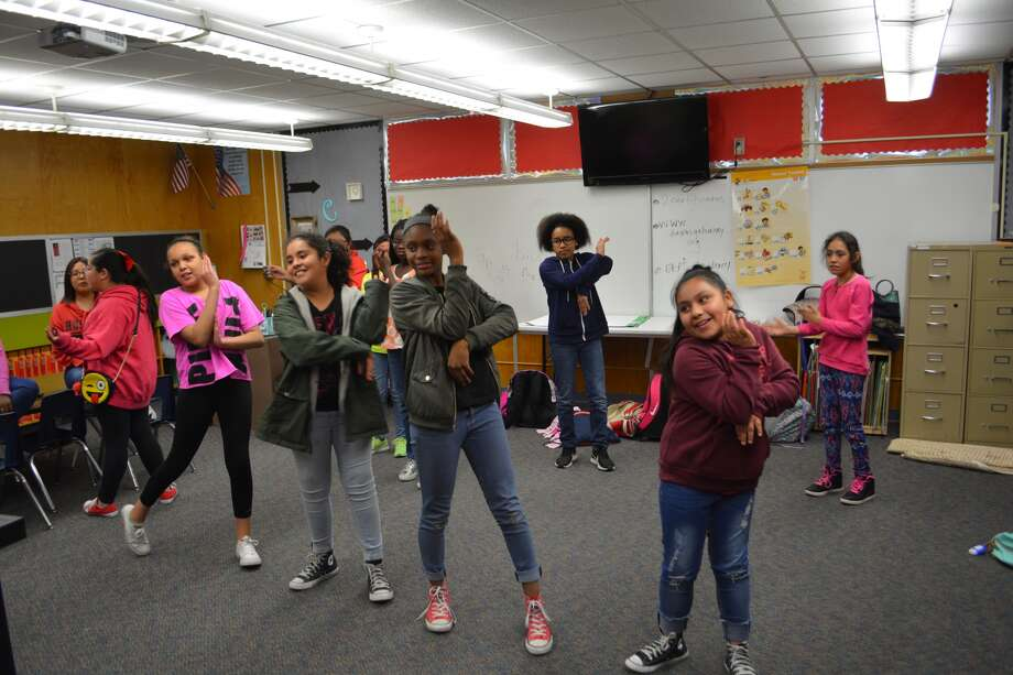 These fifth-grade girls are getting into the dance of things Wednesday at Thunderbird Elementary. Photo: William Carroll, Plainview Herald