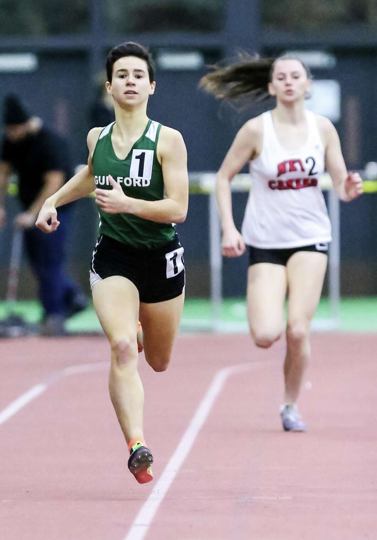 Guilford's Jaqueline Guerra leads New Canaan's Julia Ozimek and runs to capture the CIAC Class L title in the 1000 Meter run Thursday, February 8, 2018.