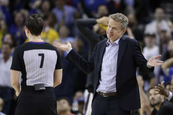 Golden State Warriors coach Steve Kerr argues a call with referee Lauren Holtkamp during the second half of the team's NBA basketball game against the Oklahoma City Thunder on Tuesday, Feb. 6, 2018, in Oakland, Calif. (AP Photo/Marcio Jose Sanchez)