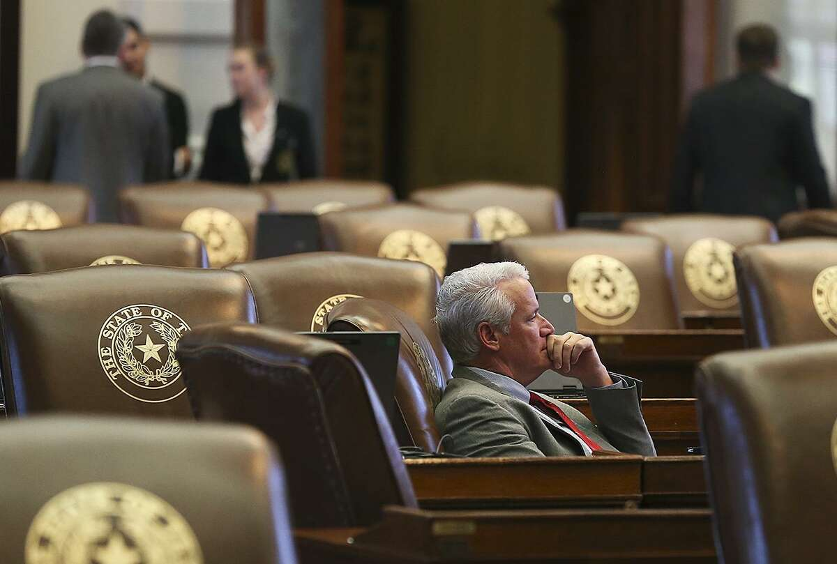 Representative Lyle Larson, R-San Antonio, contemplates as he looks toward the south windows as legislators meet in the House of Representatives on the last day of the second special session on July 30, 2013.