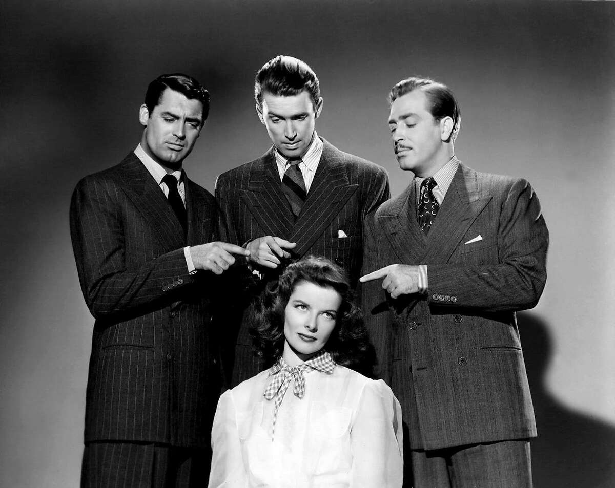 Katharine Hepburn is the center of attention in front of co-stars Cary Grant, James Stewart and John Howard in a publicity still for