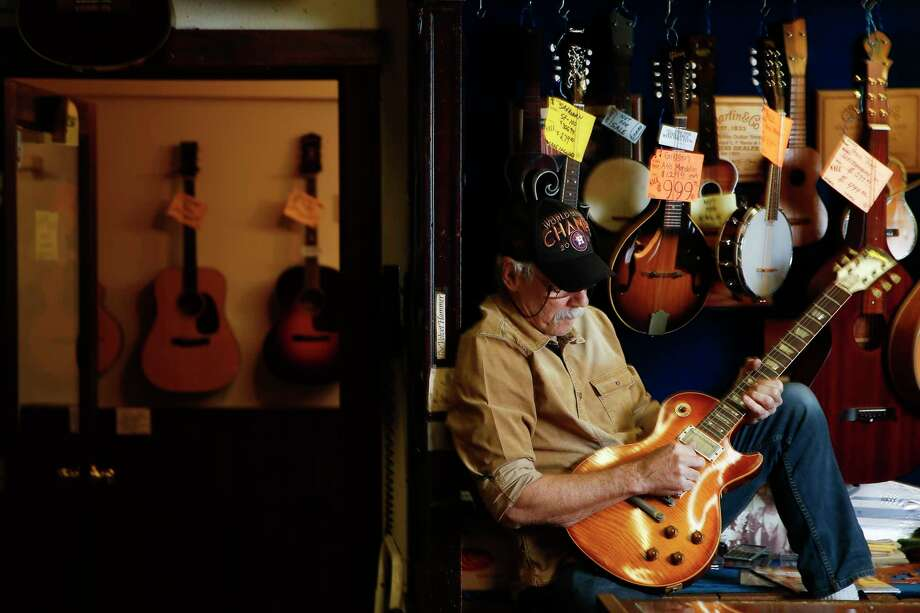 Rockin' Robin Guitars owner Bart Wittrock plays a 1959 Les Paul Conversion guitar in his store Thursday, Feb. 8, 2018 in Houston. After more than 45 years of being in business, Wittrock is putting the store on the market in hopes of finding a new and energetic owner. (Michael Ciaglo / Houston Chronicle) Photo: Michael Ciaglo, Houston Chronicle / Michael Ciaglo