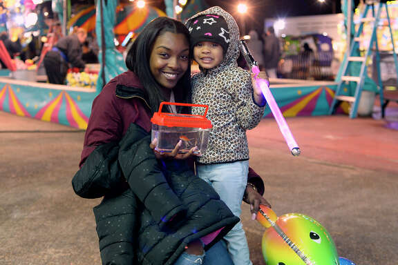 Danielle Henry and Shayann Overton on opening night of Mardi Gras of Southeast Texas in Port Arthur on Thursday.  Photo taken Thursday 2/8/18 Ryan Pelham/The Enterprise