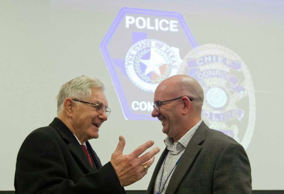Conroe Police Chief Philip Dupuis visits with Conroe Mayor Toby Powell during a luncheon in honor of Dupuis' retirement at the Conroe Police Department, Thursday, Feb. 8, 2018, in Conroe. Photo: Jason Fochtman, Staff Photographer / © 2018 Houston Chronicle