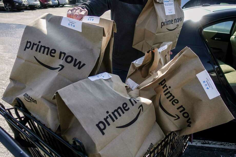 Amazon says there's no extra fee for two-hour deliveries above $35, but one-hour delivery will cost $8. Photo: John Minchillo, STF / AP