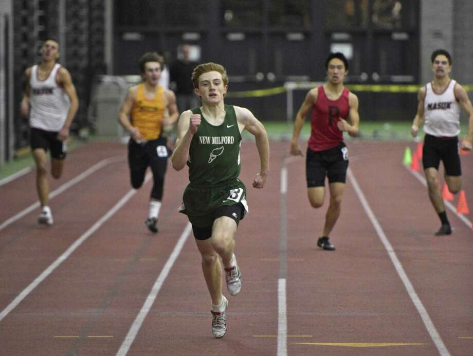 New Milford's Michael Tarby leads the field in the 300 meter dash in the SWC boys indoor track championship at Floyd Little Athletic Center, New Haven, Conn, on Saturday night, February 3, 2018. Photo: H John Voorhees III / Hearst Connecticut Media / The News-Times
