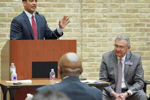 Incumbent district attorney Nico LaHood, left, and DA candidate Joe Gonzales participate in a debate, Thursday, Feb. 8, 2018 at the Claude Black Community Center in San Antonio.
