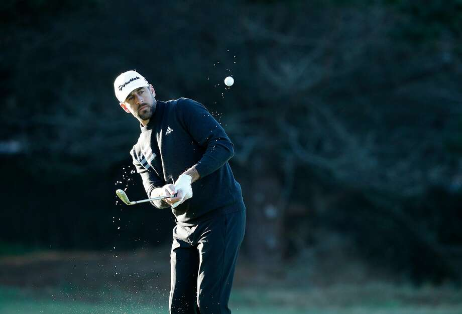 Aaron Rodgers with his chip shot on the 1st hole at the Spyglass Hill course during round 1 of the AT&T Pebble Beach Pro-Am in Pebble Beach, Calif., seen on Thursday Feb. 8, 2018. Photo: Michael Macor / The Chronicle
