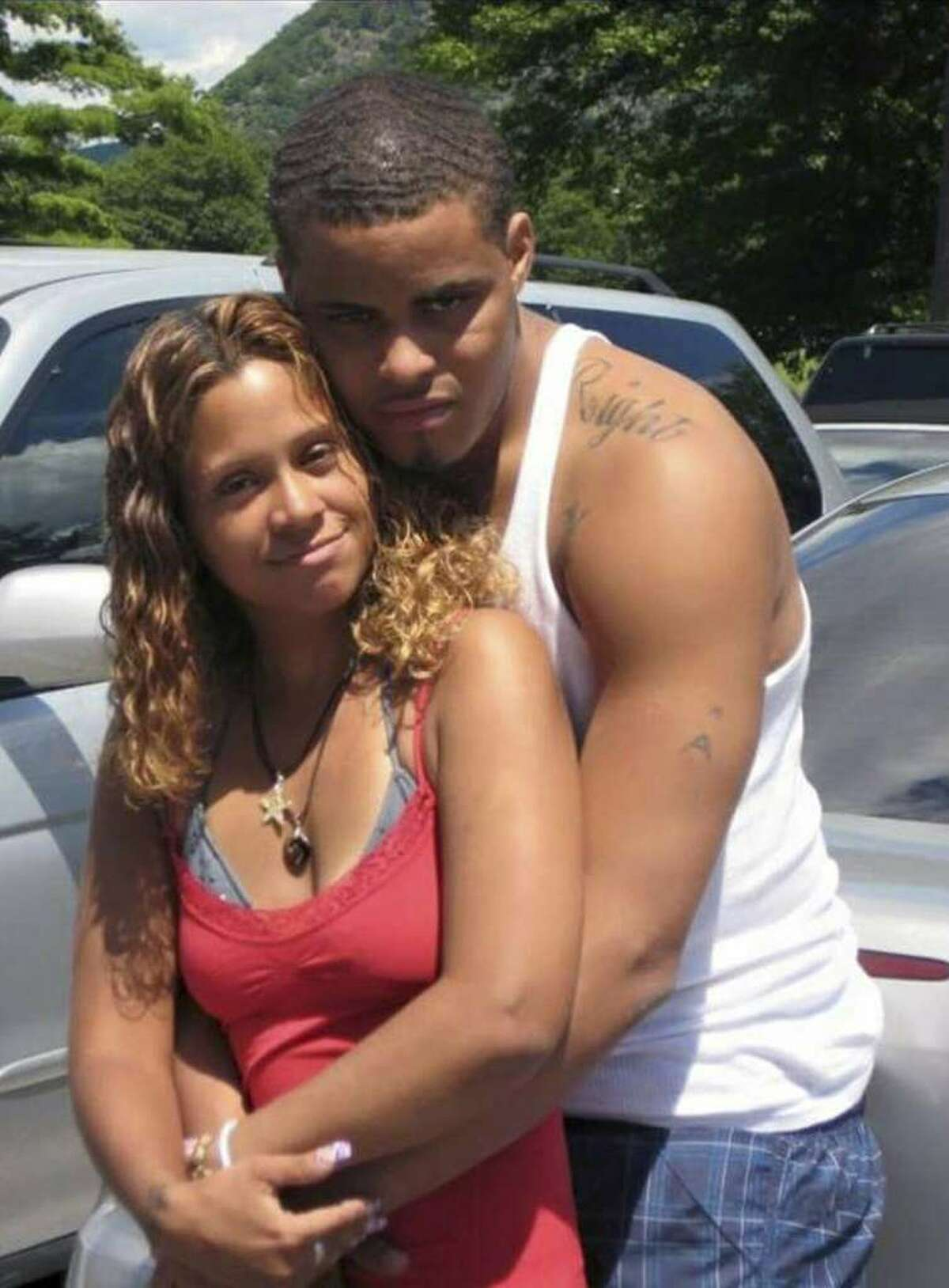 In this undated photo provided by Angelique Negroni-Kearse, Negroni-Kearse poses for a photo with her husband, Andrew Kearse. Andrew Kearse died on May 11, 2017 after leading Schenectady police on a foot chase when stopped for a traffic violation. He complained of dizziness and difficulty breathing before losing consciousness while in police custody. (Angelique Negroni-Kearse family photo via AP)