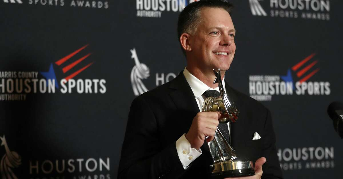 Houston Astros manager A.J. Hinch holds his award for Coach of the Year during the Houston Sports Awards at the Hilton Americas, Thursday, Feb. 8, 2018, in Houston. ( Karen Warren / Houston Chronicle )
