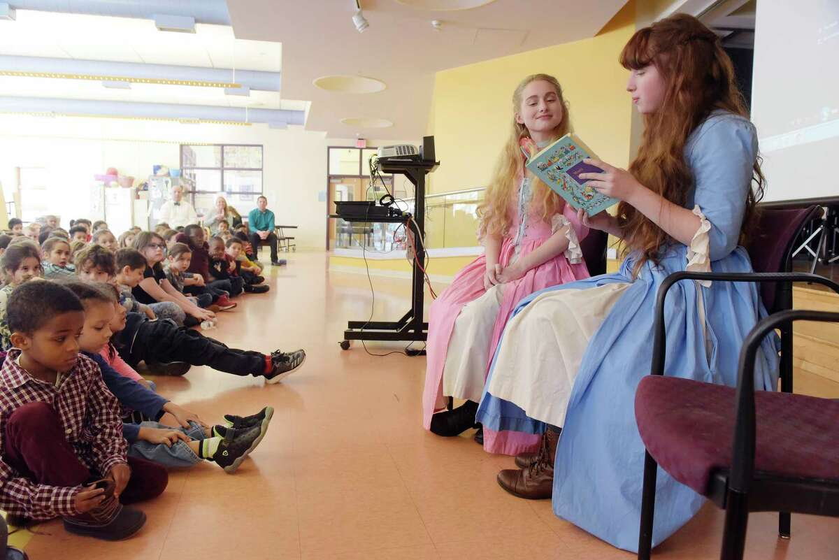 Sisters, Callista, left, 17, and Demetra, 15, Zorbas from Colonie, dressed as their characters from the television show, The Adventures of Snow White and Rose Red, take part in an event at the Montessori Magnet School on Thursday, Feb. 8, 2018, in Albany, N.Y. Ann Marie Lizzi, one of the producers, directors and editor of the series, has two children at the school and held an event to show the children how a television show is created. The show used all local actors and was filmed this past summer in and around the Saratoga Springs area. The series will be distributed through Amazon Prime sometime in the spring or early summer. A trailer for the show can be viewed on Prime. This Saturday there will be a screening of selected episodes from 10:00am to 4:00pm at the National Museum of Dance. Tickets for the screening can be purchased through www.eventbrite.com (Paul Buckowski/Times Union)