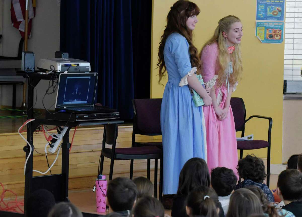 Sisters, Demetra, left, 15, and Callista, 17, Zorbas from Colonie, dressed as their characters from the television show, The Adventures of Snow White and Rose Red, take part in an event at the Montessori Magnet School on Thursday, Feb. 8, 2018, in Albany, N.Y. Ann Marie Lizzi, one of the producers, directors and editor of the series, has two children at the school and held an event to show the children how a television show is created. The show used all local actors and was filmed this past summer in and around the Saratoga Springs area. The series will be distributed through Amazon Prime sometime in the spring or early summer. A trailer for the show can be viewed on Prime. This Saturday there will be a screening of selected episodes from 10:00am to 4:00pm at the National Museum of Dance. Tickets for the screening can be purchased through www.eventbrite.com (Paul Buckowski/Times Union)