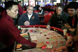 """People gamble at the public opening of Resorts World Catskills in Monticello, N.Y., Thursday, Feb. 8, 2018. The casino is opening Thursday in the heart of the old """"Borscht Belt."""" It will feature more than 150 table games and 2,150 slot machines about 80 miles northwest of New York City. Promoted as economic boost to this old resort area, it is opening in an increasingly competitive regional market. (AP Photo/Seth Wenig)"""