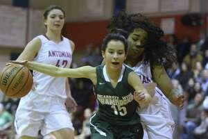 Alexis Retault (15) of Incarnate Word derives past Kayla Davis of Antonian during TAPPS high school basketball action at Antonian High School on Thursday, Feb. 8, 2018.