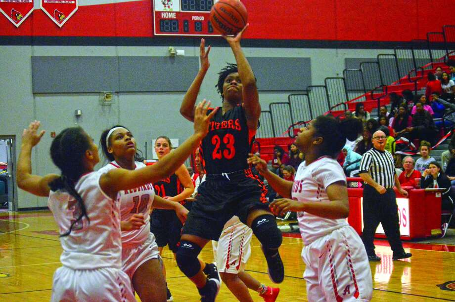 Edwardsville senior Myriah Noodel-Haywood, center, hits a shot in the lane early in the third quarter of Thursday's Southwestern Conference game at Alton.