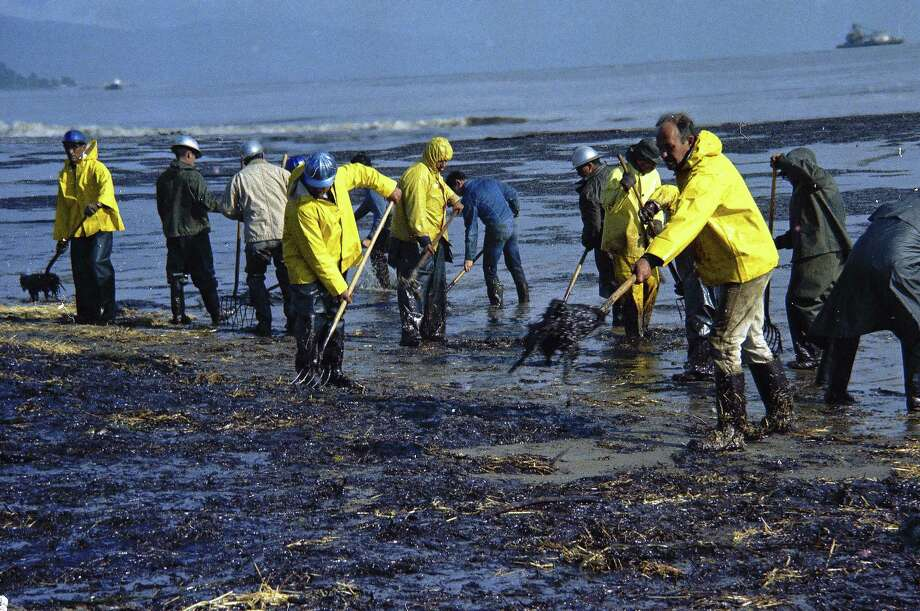 FILE - In this Feb. 6, 1969, file photo, state forestry conservation crews made up of prison convicts clean up oil-soaked straw after an oil spill on the beach in Santa Barbara, Calif. California commissions that oversee coastal lands and water pushed the Trump administration to leave the state out of plans to expand offshore drilling, warning the state would block the construction of pipelines to get oil back to land. (AP Photo/Wally Fong, file) Photo: Wally Fong, STF / 1969 AP