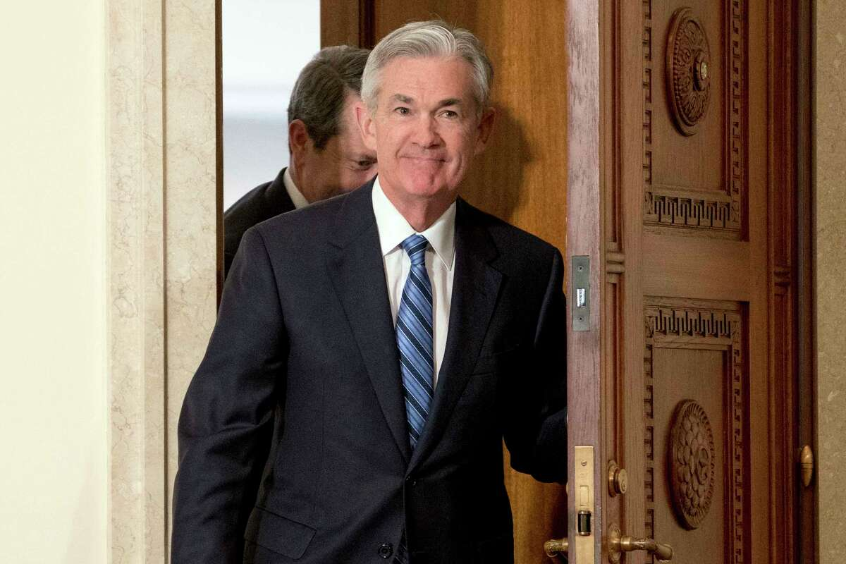 FILE- In this Monday, Feb. 5, 2018, file photo, Jerome Powell arrives to take the oath of office as Federal Reserve Board chair at the Federal Reserve in Washington. On Monday the Dow Jones industrial average endured its worst percentage drop since 2011. The market turbulence had been set off by fears that higher inflation would lead the Fed to accelerate its interest rates hikes and weaken the economy and the stock market. The worry among investors is just one of the issues Powell faces as he succeeds Janet Yellen. (AP Photo/Andrew Harnik, File)