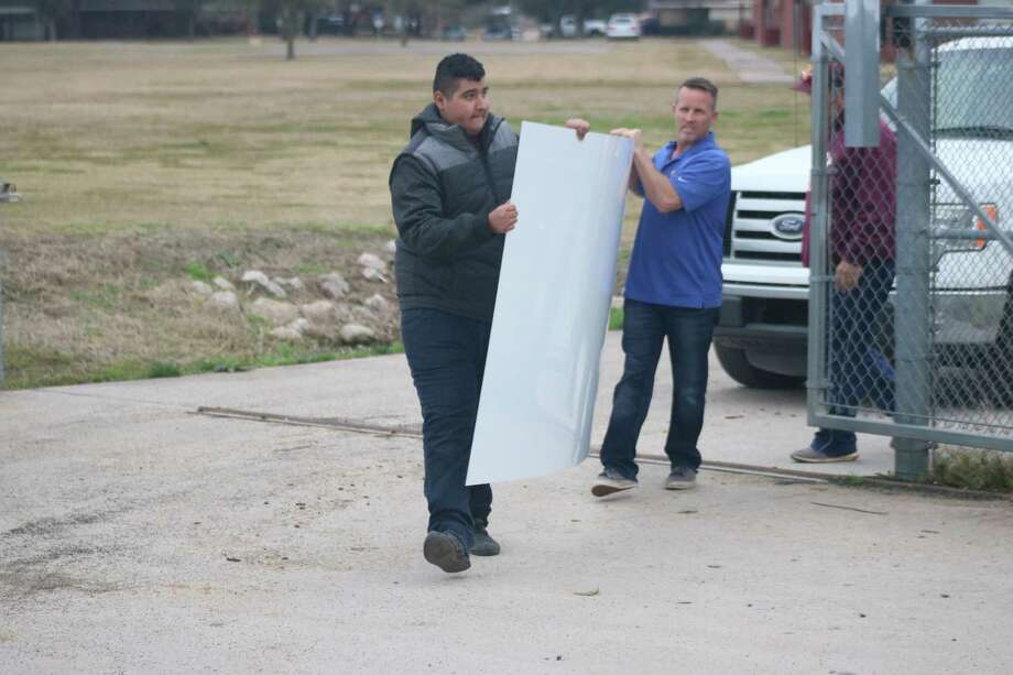 Two state championship signs are brought into Jim Kethan Field Thursday afternoon. They'll be on display in time for Deer Park's home opener. Photo: Robert Avery