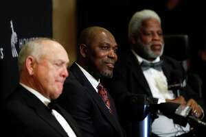 Houston's 34s Nolan Ryan, Hakeem Olajuwon, and Earl Campbell together during a press conference after the Houston Sports Awards at the Hilton Americas, Thursday, Feb. 8, 2018, in Houston.