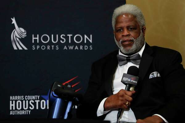 Earl Campbell speaks to the media as he and Houston's 34s Nolan Ryan and Hakeem Olajuwon got together during a press conference after the Houston Sports Awards at the Hilton Americas, Thursday, Feb. 8, 2018, in Houston.