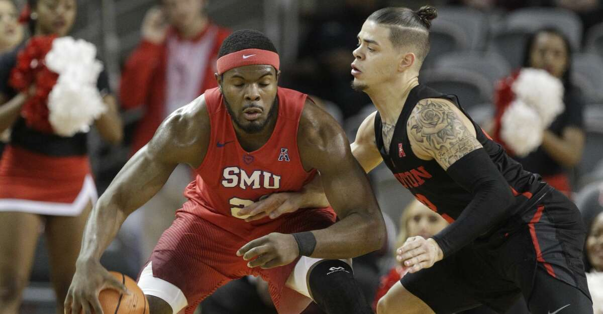 Southern Methodist University Ben Emelogu II works to keep ball from University of Houston Rob Gray during the first half of game at Texas Southern University Thursday, Feb. 8, 2018, in Houston. ( Melissa Phillip / Houston Chronicle )