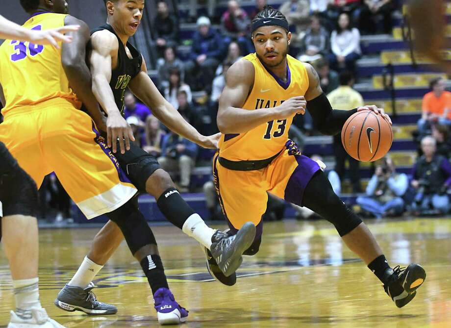 University at Albany's David Nichols drives to the basket during a basketball game against Vermont at SEFCU Arena on Thursday, Feb. 8, 2018 in Albany, N.Y. (Lori Van Buren/Times Union) Photo: Lori Van Buren / 0042387A
