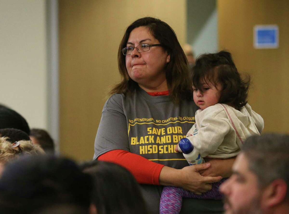 """Cladia Rios wears """"Save Our Black and Brown HISD Schools"""" t-shirt to attend Houston ISD Board of Trustees public hearing at Hattie Mae White Educational Support Center on Thursday, Feb. 8, 2018, in Houston. It was the first hearing from the HISD community for the first time since plans were announced for major changes at 14 low-performing schools, and the hundreds came to the hearing. The back of the t-shirt listed the names and years of establishment of those 14 schools. Rios or her family did not go to one of the 14 schools but showed up to support the schools to remain open."""