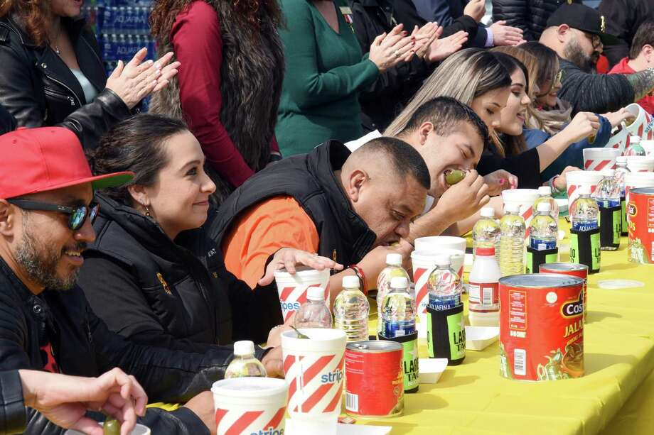 Contestants are shown eating spicy peppers during the Stripes Media/Celebrity Jalapeño Eating Challenge at store 2519, off Jacaman Road on Thursday. Photo: Christian Alejandro Ocampo /Laredo Morning Times / Laredo Morning Times