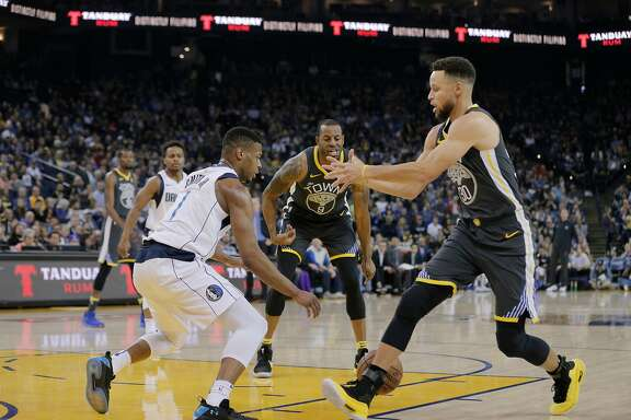 Golden State Warriors guard Stephen Curry (30) loses the ball during the first half as the Golden State Warriors played the Dallas Mavericks at Oracle Arena in Oakland, Calif., on Thursday, February 8, 2018.