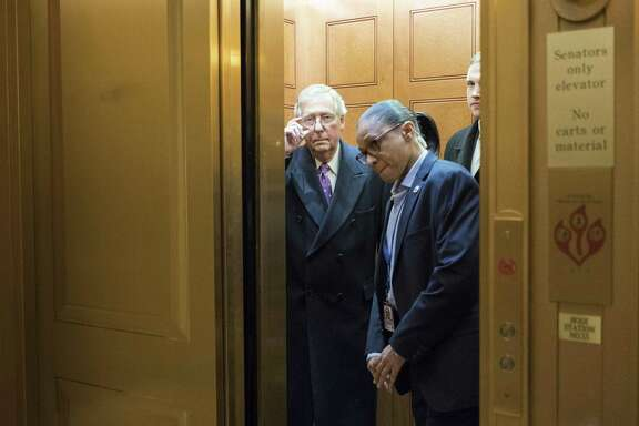 Senate Majority Leader Mitch McConnell (R-Ky.) takes an elevator as a budget deadline approached, on Capitol Hill in Washington, Feb. 8, 2018. The federal government on Thursday night slid toward at least a brief shutdown as Kentuckyís other Republican senator, Rand Paul, delayed a vote on a far-reaching budget deal in a floor speech in bemoaning out-of-control government spending. (Erin Schaff/The New York Times)