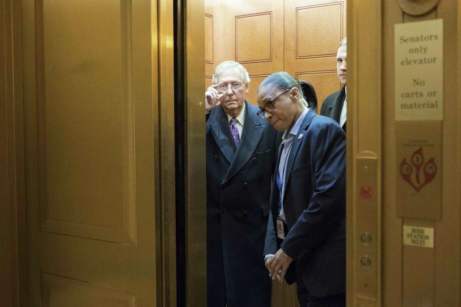 Senate Majority Leader Mitch McConnell (R-Ky.) takes an elevator as a budget deadline approached, on Capitol Hill in Washington, Feb. 8, 2018. The federal government on Thursday night slid toward at least a brief shutdown as Kentuckyís other Republican senator, Rand Paul, delayed a vote on a far-reaching budget deal in a floor speech in bemoaning out-of-control government spending. (Erin Schaff/The New York Times) Photo: ERIN SCHAFF / NYT / NYTNS