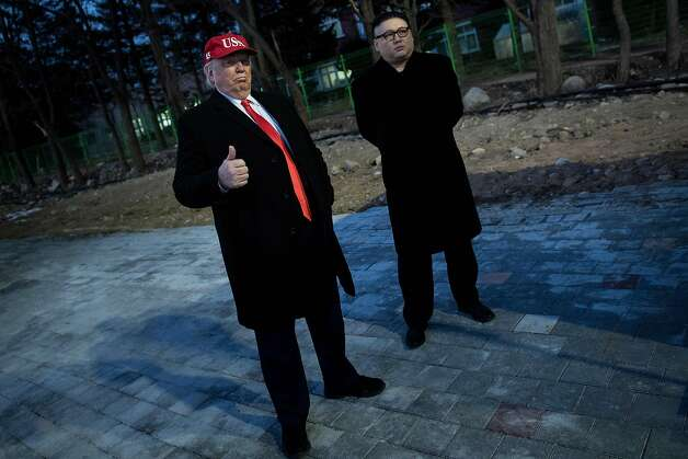 A man impersonating US President Donald Trump (L) and another impersonating Kim Jong-un wait to enter the opening ceremony of the Pyeongchang 2018 Winter Olympic Games at the Pyeongchang Stadium on February 9, 2018.  Photo: BRENDAN SMIALOWSKI, AFP/Getty Images