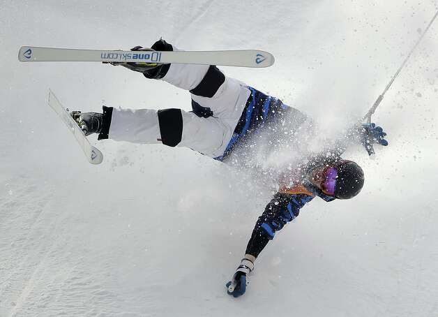 Jussi Penttala, of Finland, crashes during the men's moguls qualifying at Phoenix Snow Park at the 2018 Winter Olympics in Pyeongchang, South Korea, Friday, Feb. 9, 2018.  Photo: Gregory Bull, Associated Press