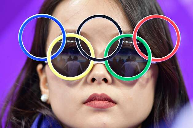 A woman wears Olympic rings sunglasses during the figure skating team event men's single skating short program during the Pyeongchang 2018 Winter Olympic Games at the Gangneung Ice Arena in Gangneung on February 9, 2018.  Photo: MLADEN ANTONOV, AFP/Getty Images